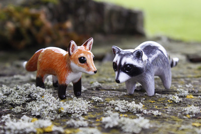 red_fox_and_raccoon_figurines_by_byrdis-d81vix8